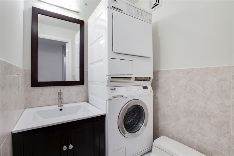 powder room with washer dryer