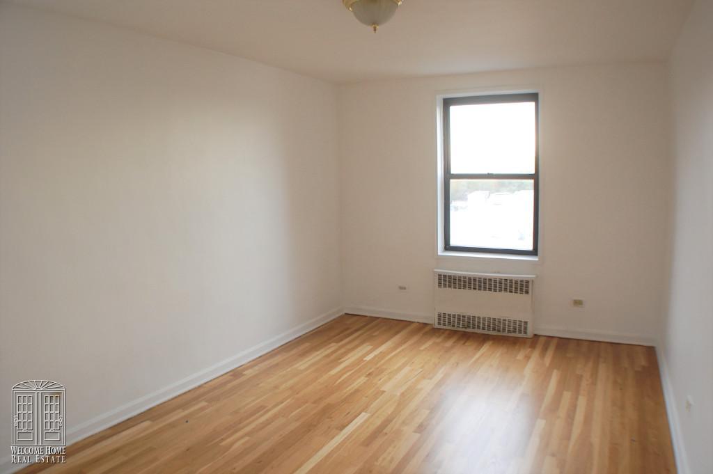 Corner Bedroom view 1