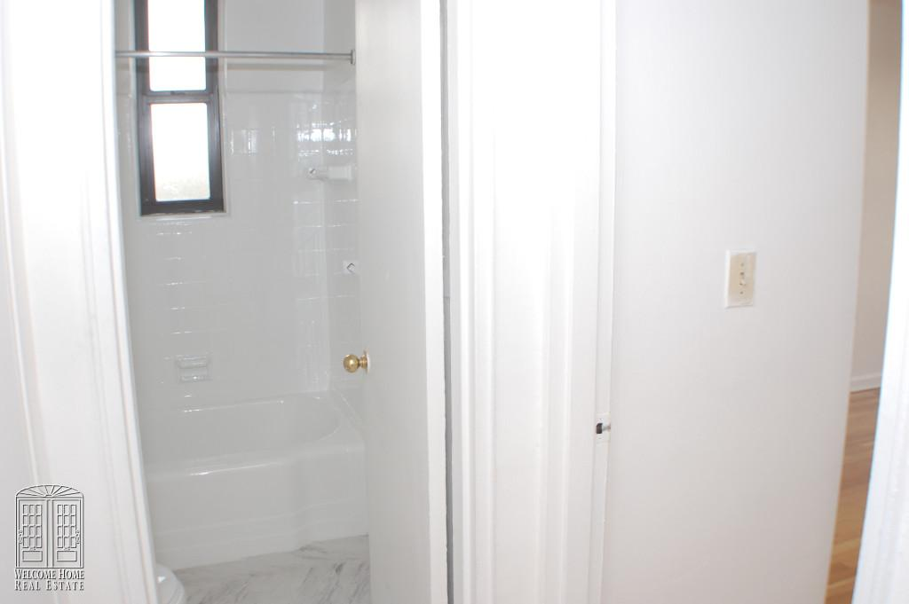 View of bathroom and BR