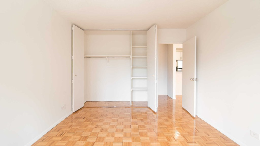 Bedroom with Wood Parquet Floor and Full-sized Closet