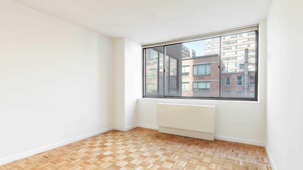 Bedroom with Parquet Flooring