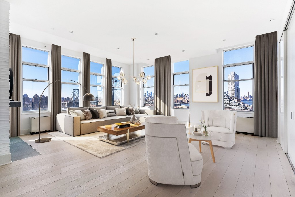 Brooklyns largest one level residence with 5 bedrooms, 4.5 bathrooms, soaring 13 high ceilings, lofty pillars and two custom gas fireplaces, meticulously constructed from the the seamless merging of two 3 bedroom and 2.5 bathroom corner units. This stunning Williamsburg loft has unparalleled 270 degrees of the water and Manhattan skyline across 30 windows. Located on the highest corner to corner floor of The Gretsch, a luxury condominium converted from a 1916 Gretsch guitar factory. Enjoy endless views from every room. From the living room, entertain with views of the Empire State Building and the Williamsburg Bridge. From the kitchen, watch the boats sail by the Manhattan & Brooklyn Bridges, the Brooklyn Navy Yard and Downtown Brooklyn skyline. On a clear day you can identify 5 to 7 bridges. An open style fully equipped contemporary German chef kitchen features top of the line stainless steel appliances and conveniently merges with the large infinity dining area. The master bedroom has an adjacent custom-designed walk-in closet. Two en-suite his and hers extra-large airy spa-like master bathrooms feature separate glass and stone showers with rainforest shower heads and enormous soaking tubs. The renovated roof deck is perfect for sunbathing and entertaining. Additional amenities include a 24-hour doorman, full time superintendent, a bike room, and a newly renovated playroom. Perfectly located in South Williamsburg, the Gretsch is in close proximity to many of the areas best restaurants, shopping, Domino Park, the East River ferry stop and other public transportation options (J/M/Z & L subway lines and buses), and the Williamsburg Bridge.