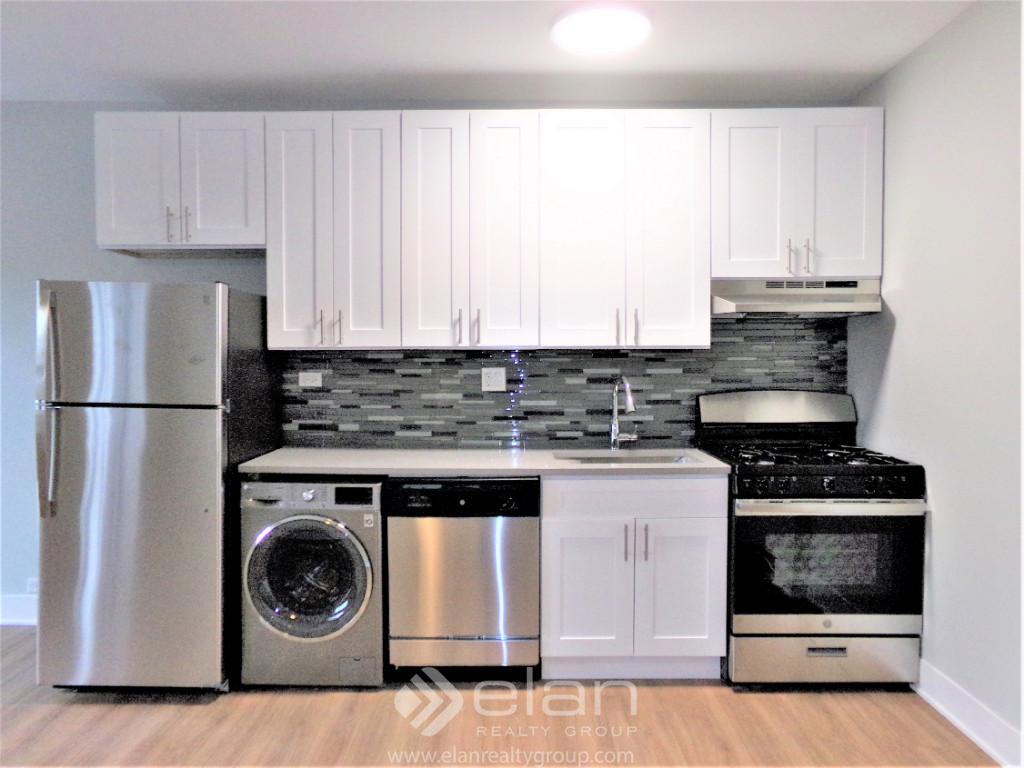 Open Kitchen W~ In Unit Laundry