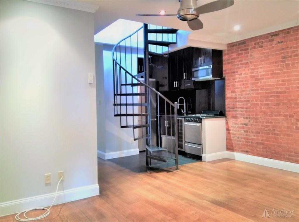 NO FEE!!! For this newly renovated 4 bedroom  w/ PRIVATE ROOF DECK and Washer and dryer in uni