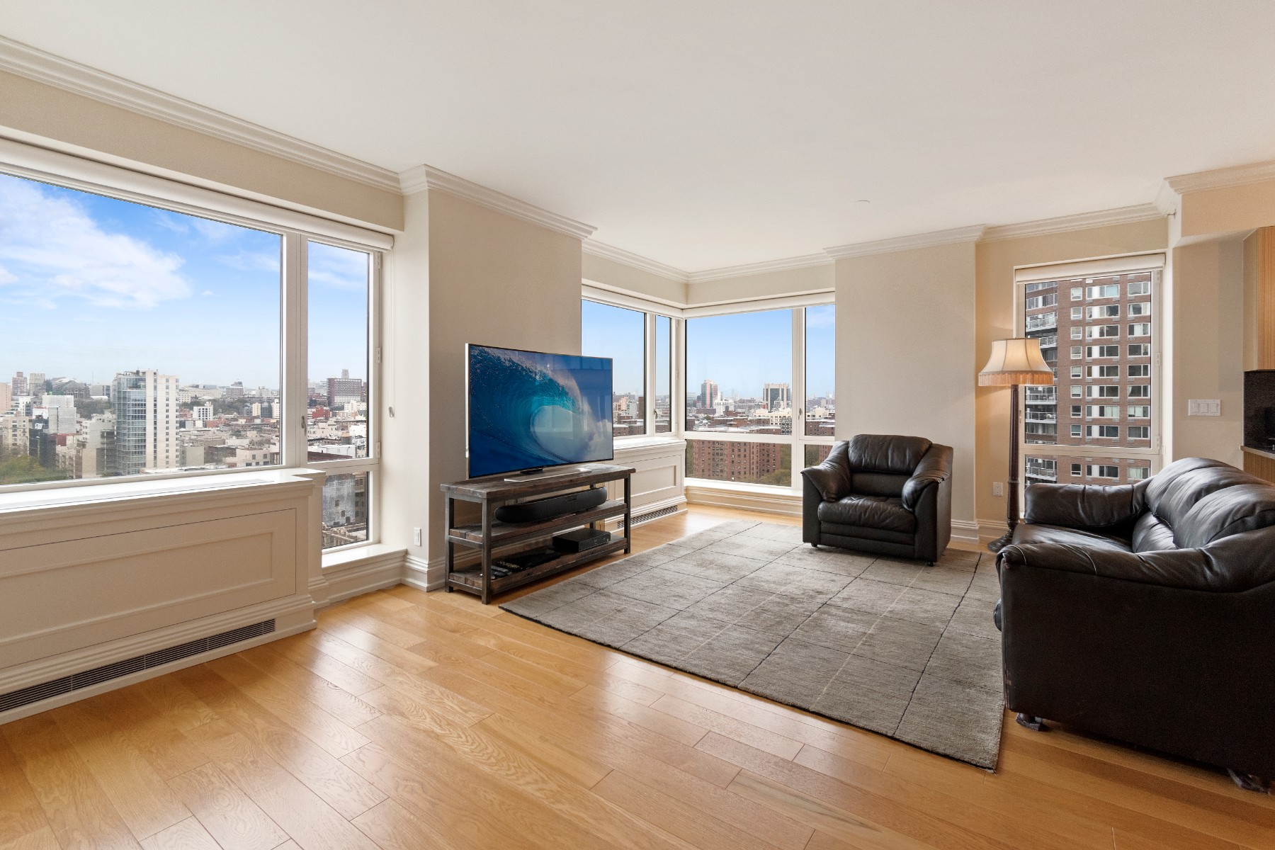 Perched on a high floor with unobstructed views of Central Park and the Manhattan skyline, this 3-bedroom apartment benefits from excellent lighting throughout as a result of its floor-to-ceiling windows and its Northern and Western exposure. The open layout allows for a large living room and dining area that is perfect for entertaining guests. This spacious and gracious 1,863 SF 3-bedroom, 3.5-bath offers a top-of-the-line open chefs kitchen with granite counter tops and custom made cabinetry, 10' ceilings, beautiful crown moldings, a washer/dryer that can be found in the guest powder room conveniently located off the living room, and hardwood floors throughout the apartment. All of the bedrooms have an en-suite bathroom. The master bedroom has a limestone en-suite bathroom with a stall shower, a soaking tub designed by Zuma, and double sink with marble counter tops made by Bianco Dolomiti. It also offers a one of a kind walk-in closet that is a unique addition for A line units.Building: 1280 5th Avenue was designed by the renowned American architect Robert A. M. Stern. It offers exceptional architecture, layout and design. The building offers excellent amenities such as: 24-hour doorman, concierge and live-in super, fitness center, children's play room, teen game room, parking (if available), a landscaped roof deck with BBQ grill, catering kitchen, formal dining room, and swimming pool. Location: The residences at One Museum Mile sit atop the Africa Center / Museum. The location provides convenient access to world-famous Museums, restaurants, shopping, and hospitals. The 2,3,4 and 6 trains, and multiple bus lines are located within minutes of 1280 5th Avenue.