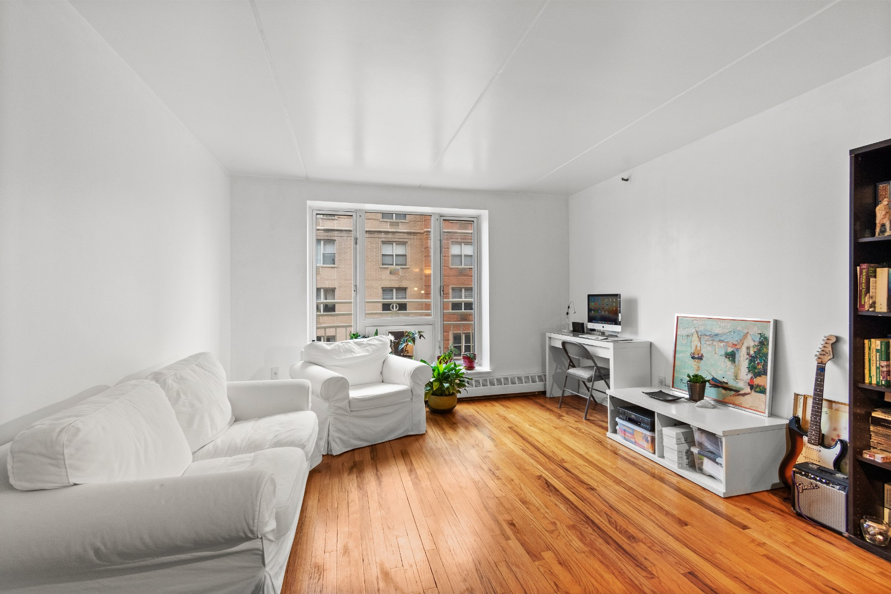 This beautiful corner unit is a two-bedroom, 2 bath apartment that offers incredible light throughout, Southern and Eastern exposure in the heart of Harlem. This apartment enjoys a spacious living room/dining area open for entertaining guests and a Juliet door windows. The partially open kitchen has been renovated and it offers stainless steel appliances. The master bedroom has an en-suite bathroom and a large walk-in closet. The apartment also features solid oak hardwood floors throughout.BUILDING: This pet-friendly building was built in 2004. The Madison Plaza offers the convenience of a full-time doorman, live-in super, central laundry, fitness room, bike storage, and a planted courtyard with BBQ grill for shareholders.Location: Located a few blocks away from Central Park and two blocks from Marcus Garvey Park, this area offers plenty of shopping, entertainment, and different methods of transportation such as Metro North, M60 La Guardia, and subway train access.This is an income-restricted building. The maximum household income allowed for this unit is $284,250.