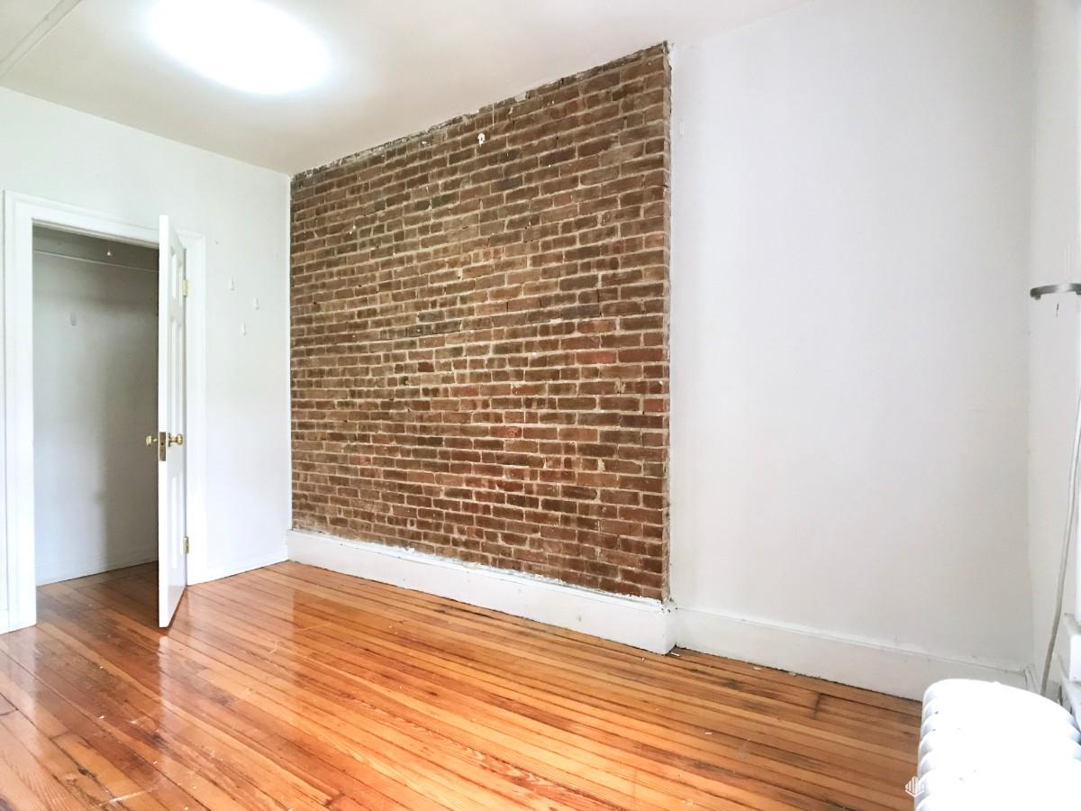 BEDROOM #4 w/ exposed brick