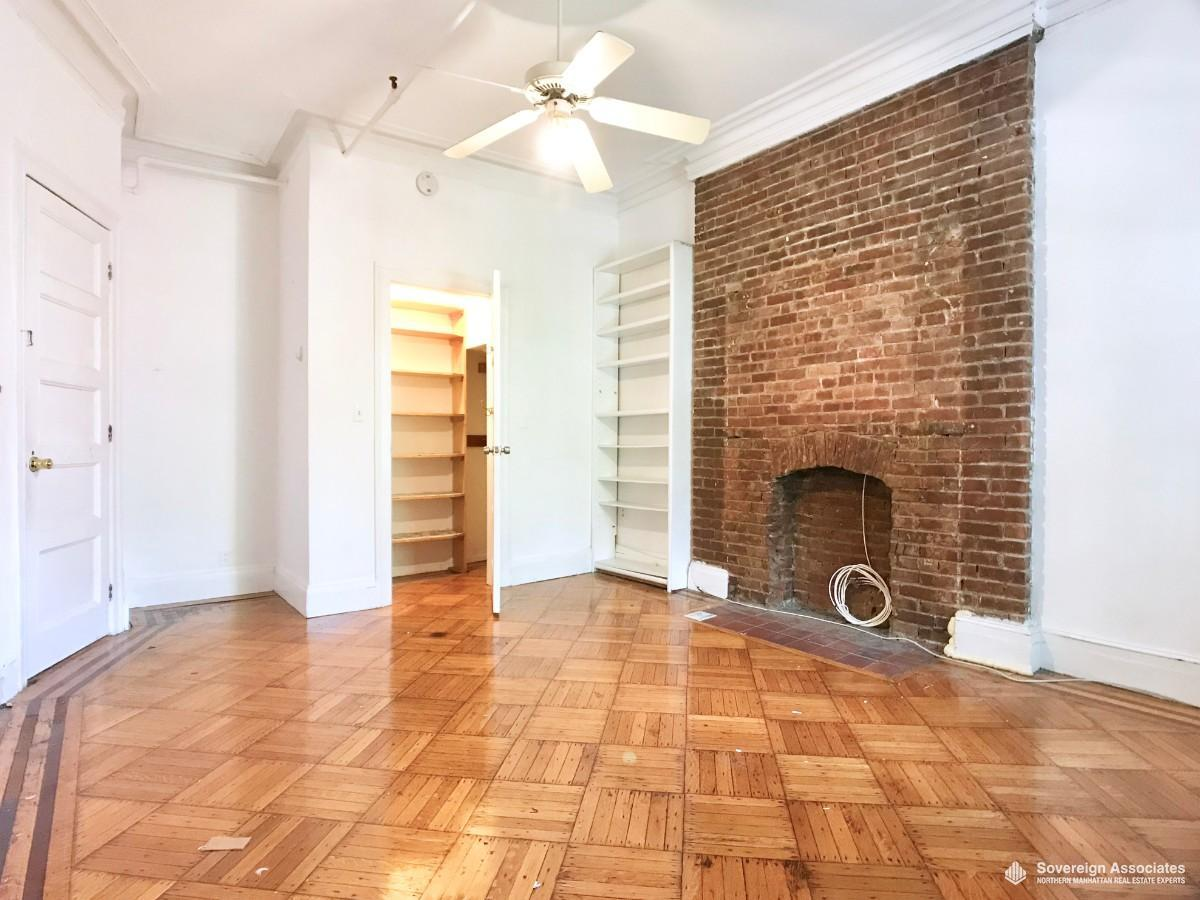 BEDROOM #3 w/ expose brick fireplace (non-working)