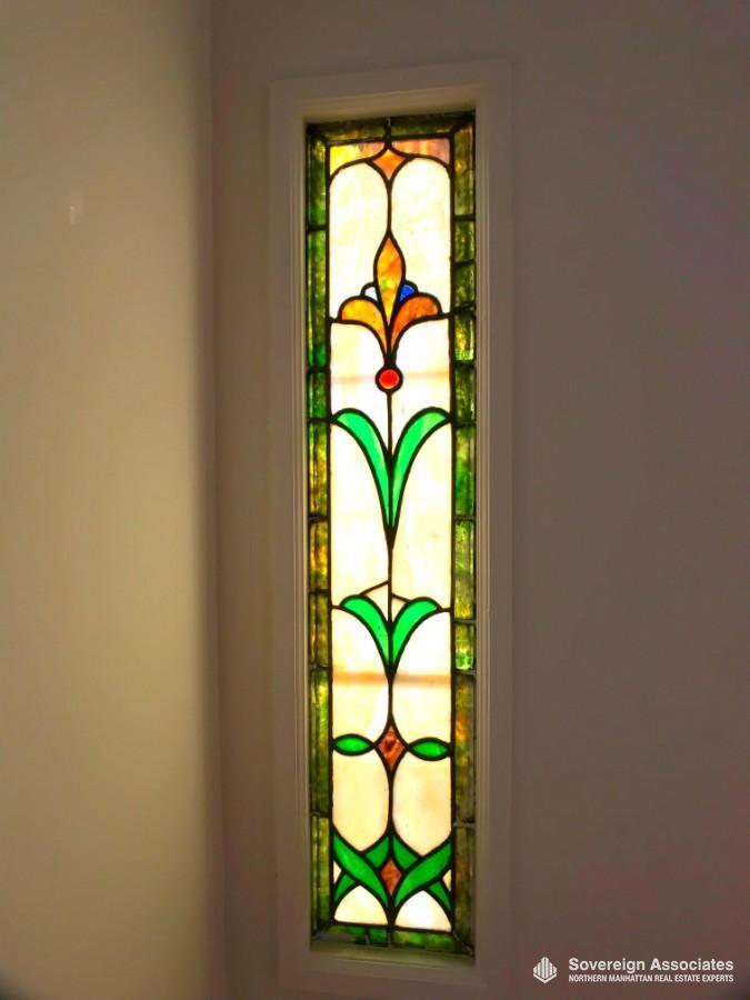 1 of 2 original stain glass windows