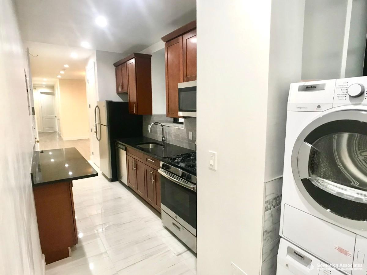 GRANITE KITCHEN with laundry