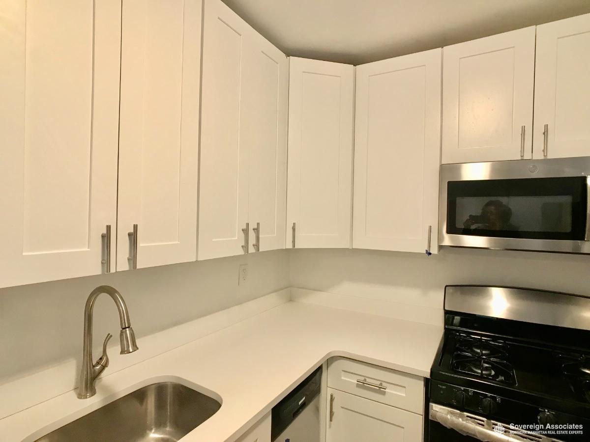 White Cabinets and White silestone countertops
