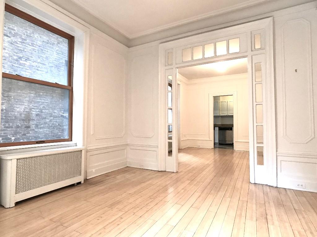 LIVING ROOM toward dining/kitchen