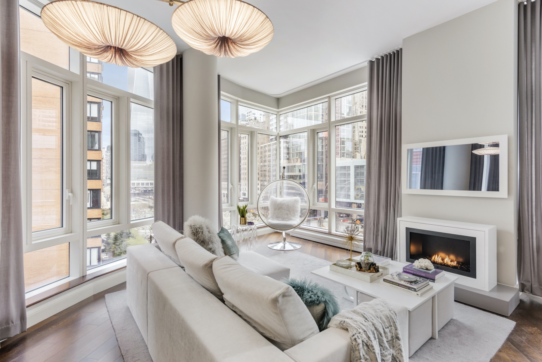 Looking for LUXURY? Own your own piece of Heaven in the heart of Battery Park City designed especially for the most privy by renowned interior designer Lo Chen. For the exclusive buyer, this stunner comes fully furnished... Lucky youUpon entering your fully-furnished sunlit corner home, youll immediately be wowed by the soaring 11-foot floor to ceiling windows which provide a full view of the Freedom Tower and beautiful treelined streets below. Whether reading a book in your nook, enjoying the fire, or entertaining guests, the living room is ready to impress!The open concept chefs kitchen is equipped with eco black Riverstone countertops, sub-zero Wolfe and Miele appliances, and bamboo cabinets. Perfect for your inner chef, or any in-home catered event. After a long day at the office, head into the limestone and glass mosaic tile bathroom for a soak in the extra deep Waterworks tub before making your way into your glorious bedroom to relax and sleep the night away!Staying true to the luxurious feel this condo has to offer, the furniture in the unit is no different: Milano Smart living sofa and coffee table imported from ItalyFreely moving mobile lighting by Aqua Creations imported from Tel AvivThe dining table is the famous Saarinen Marble Table by KnollArt installation by Jeffrey GoodmanPaintings by LumasSmall custom shelf vases by Na SuenThe drapery and custom automated shades are by The Shade Store and the TV is a hidden mirror TV with custom frame The custom fireplace is by Hearth cabinets and there are many more custom and hand-picked items throughoutDesigned by world renowned architect, Pelli Clarke Pelli, The Visionaire is Manhattan's first green LEED Platinum certified residential property with purified filtered air, solar panels, and a full suite of white-glove amenities, including:24-hour doorman and concierge service24/7 valet parking garage and bike storageA state-of-the-art fitness center that offers classesYoga studioSunlit saltwater swimming poolJacuz